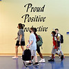 Eastside Elementary School students walk to their classrooms passing a large reminder on the wall to be Proud, Positive and Productive on the first day of classes at ACS.