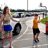 Eastside Elementary School speech therapist Sharon Turner greets students as their parents drop them off Wednesday morning on the first day of school.