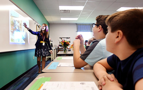 John P. Cleary   The Herald Bulletin<br /> First-year teacher Jenny Miller conducts her fifth-grade class on the first day of school at Anderson Intermediate School. Fresh out of college Miller said she always wanted to be an educator.