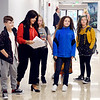 John P. Cleary | The Herald Bulletin<br /> Anderson Intermediate School principal Ashley Gustin helps these students find their classrooms on the first day of school for Anderson Community Schools Wednesday.