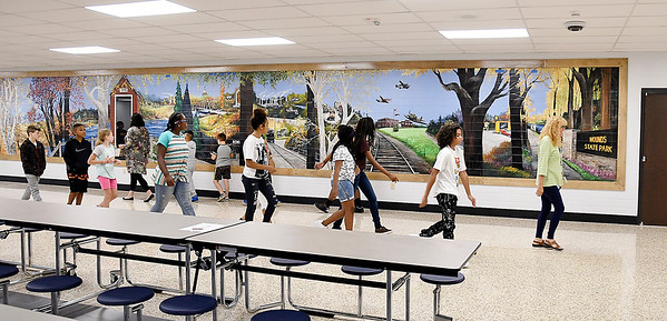 John P. Cleary | The Herald Bulletin<br /> Anderson Intermediate School classes take a tour around the building to help get familiar with the location of some of the facilities on the first day of school Wednesday.