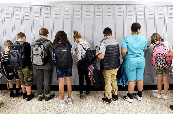 John P. Cleary | The Herald Bulletin<br /> Students of the new Anderson Intermediate School check out their new lockers on the first day of classes Wednesday.