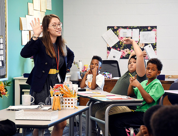 John P. Cleary   The Herald Bulletin<br /> First-year teacher Jenny Miller asks questions of her fifth-grade students as they get acquainted on the first day of classes at the new Anderson Intermediate School.