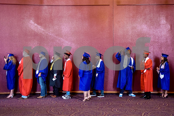 Graduates wait for commencement to begin during Tyler ISD's summer graduation for John Tyler High School, Robert E. Lee High School and Rise Academy at Caldwell Auditorium in Tyler, Texas, on Friday, Aug. 10, 2018. (Chelsea Purgahn/Tyler Morning Telegraph)