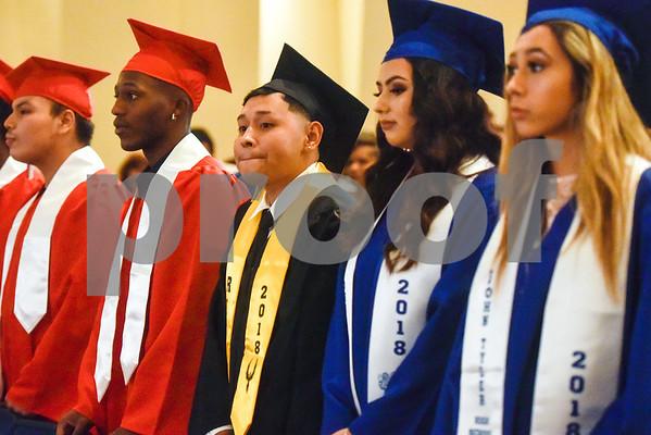 Graduates stand during Tyler ISD's summer graduation for John Tyler High School, Robert E. Lee High School and Rise Academy at Caldwell Auditorium in Tyler, Texas, on Friday, Aug. 10, 2018. (Chelsea Purgahn/Tyler Morning Telegraph)