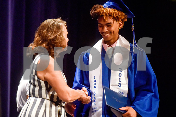 Board member Patricia Nation shakes Landon Bowie's hand during Tyler ISD's summer graduation for John Tyler High School, Robert E. Lee High School and Rise Academy at Caldwell Auditorium in Tyler, Texas, on Friday, Aug. 10, 2018. (Chelsea Purgahn/Tyler Morning Telegraph)