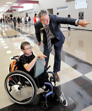 John P. Cleary | The Herald Bulletin<br /> Highland Middle School new principal, Dr. Kyle Barrentine, helps eighth-grade student Kai Merkle find his way to his next class Wednesday on the first day of classes for Anderson Community Schools.
