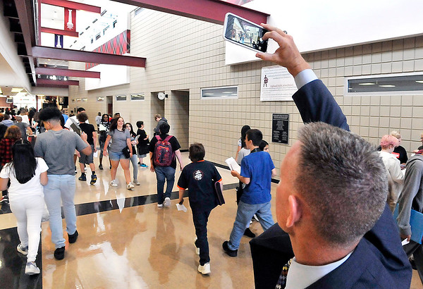 John P. Cleary | The Herald Bulletin<br /> Highland Middle School new principal, Dr. Kyle Barrentine, takes photos during passing period on the first day of classes at his new school.