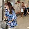John P. Cleary | The Herald Bulletin<br /> Erskine Elementary School new principal Kathleena McCord goes down the hallway on her scooter on the first day of school for ACS Wednesday. McCord broke her leg two days before starting her new position with ACS last month and has a large boot on her leg and foot.