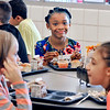 John P. Cleary | The Herald Bulletin<br /> New Erskine Elementary fourth-grade student, Jai'leah Jones, 9, enjoys lunch with new friends as she transferred from Liberty Christian School for this new school year.