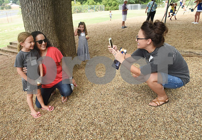 Liz Hinch takes a photograph of her daughter Emerson Hinch, 5, with Grace Community School Spanish teacher Lisa Buchanan Saturday August 13, 2016 during the kindergarten picnic at the elementary school. Classes begin Wednesday for Grace Community School.  (Sarah A. Miller/Tyler Morning Telegraph)