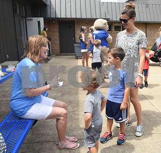 Jamie Kirby watches as her sons Luke Kirby, 3, and Beau Kirby, 6, get an autograph from Grace Community School elementary principal Jennifer Dozier during the kindergarten picnic Saturday August 13, 2016. The annual kindergarten picnic was held to familiarize the new young students with their school, classmates and teachers. Classes begin Wednesday for Grace Community School.  (Sarah A. Miller/Tyler Morning Telegraph)
