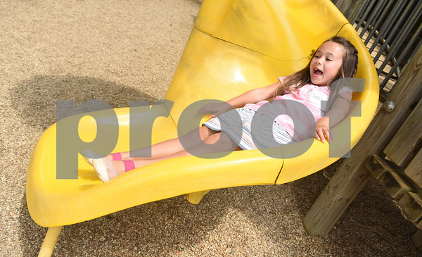 Natalie Schum, 5, goes down the slide after eating lunch at Grace Community School Saturday August 13, 2016 during the kindergarten picnic. Classes begin Wednesday for Grace Community School.  (Sarah A. Miller/Tyler Morning Telegraph)