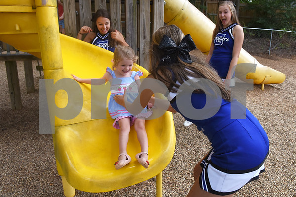 Junior kindergartener Noel Grace Bohl, 4, is helped down the side by Grace Community School cheerleaders Mary Catherine Wallace, Carly Furqueron and Ashlyn Akin  during the junior kindergarten popsicle playdate Saturday August 13, 2016. The annual event was held to familiarize the new young students with their school, classmates and teachers. Classes begin Wednesday for Grace Community School.  (Sarah A. Miller/Tyler Morning Telegraph)