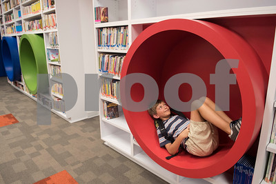 All Saints Episcopal School student Owen Adcock, 9, sits in a cubby to read at the Collaboratory, a new interactive learning space at the All Saints Episcopal School Lower School Tuesday Aug. 15, 2017.  (Sarah A. Miller/Tyler Morning Telegraph)
