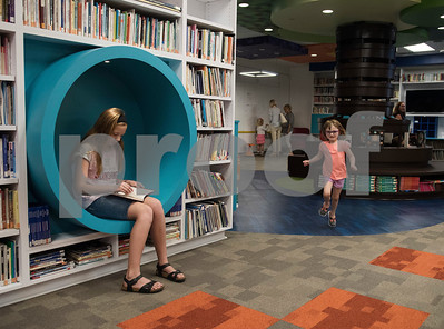 All Saints Episcopal School student Kathryn Sellers, 11, sits in a cubby to read at the Collaboratory, a new interactive learning space at the All Saints Episcopal School Lower School Tuesday Aug. 15, 2017.  (Sarah A. Miller/Tyler Morning Telegraph)