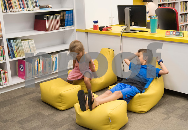 Siblings Dakota Johnson, 4, and Braiden Cooper, 8, try the bean bag chairs at the Collaboratory, a new interactive learning space at the All Saints Episcopal School Lower School Tuesday Aug. 15, 2017.  (Sarah A. Miller/Tyler Morning Telegraph)