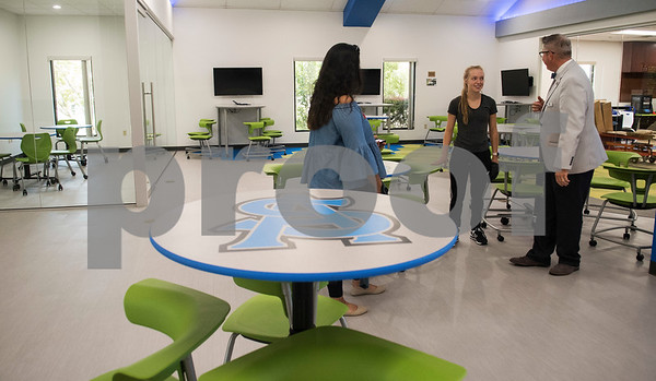 Students Sarah Osman, 17, and Sam Morgan, 17, talk with Head of School Mike Cobb about the transformation of the former library at All Saints Episcopal School has been transformed into an innovation area, as seen here Tuesday Aug. 15, 2017.  (Sarah A. Miller/Tyler Morning Telegraph)
