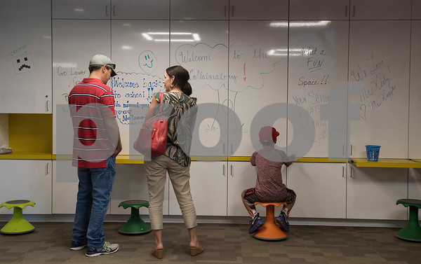 Sean Sanders, Lindy Sanders and their son Luke Sanders, 8, tour the Collaboratory, a new interactive learning space at the All Saints Episcopal School Lower School Tuesday Aug. 15, 2017.  (Sarah A. Miller/Tyler Morning Telegraph)