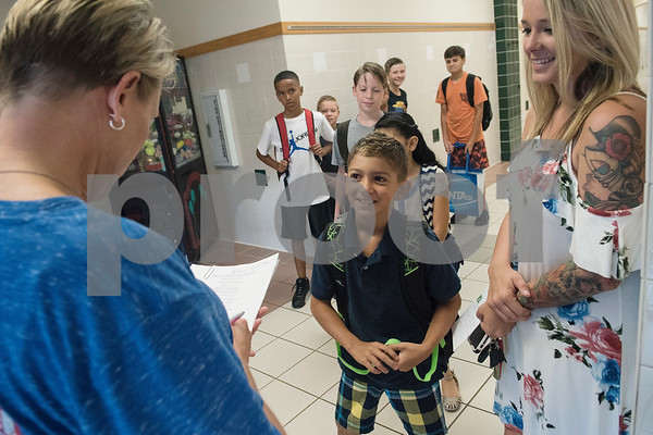 Fifth grade teacher Amy Cooksy meets student Kalvin Dryman, 10, and his mother Lacey Dryman on the first day of classes after summer vacation at Stanton-Smith Elementary School in Whitehouse Wednesday Aug. 16, 2017.   (Sarah A. Miller/Tyler Morning Telegraph)