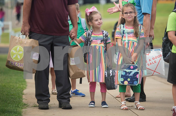 Twin sisters Maggie and Anna Trimble, 6, arrive for their first day of kindergarten at Stanton-Smith Elementary School in Whitehouse Wednesday Aug. 16, 2017.   (Sarah A. Miller/Tyler Morning Telegraph)
