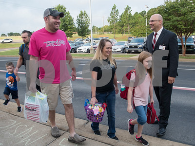 Whitehouse Independent School District Superintendent Dr. Christopher Moran, right, welcomes parents and students to Stanton-Smith Elementary School in Whitehouse on the first day back to school from summer vacation Wednesday Aug. 16, 2017.   (Sarah A. Miller/Tyler Morning Telegraph)