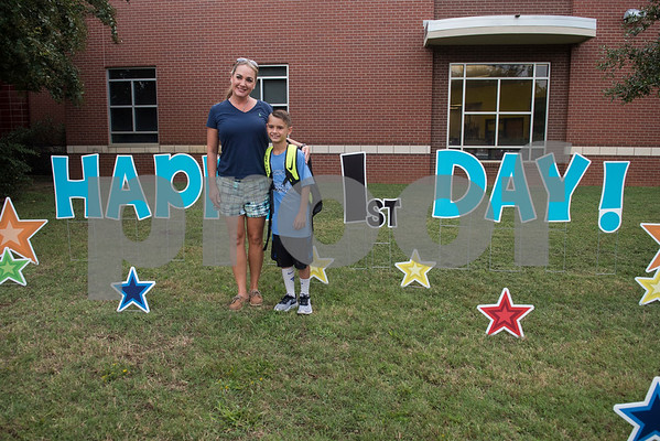 Holley Kidd and her son Levi Kidd, 8, have their photo taken outside of Stanton-Smith Elementary School in Whitehouse on the first day back to school from summer vacation Wednesday Aug. 16, 2017.   (Sarah A. Miller/Tyler Morning Telegraph)