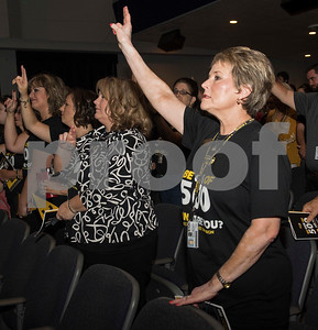 Tyler Junior College employees wave their arms as they sing the alma mater during the annual fall convocation Tuesday, Aug. 15, 2017 at Wise Auditorium.  (Sarah A. Miller/Tyler Morning Telegraph)