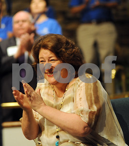 copyright 2012 Sarah A. Miller/Tyler Morning Telegraph  Special guest Margo Martindale applauds for recipients of the Influential Indian award at the Jacksonville Independent School District 2012-2013 Convocation Friday morning at Central Baptist Church in Jacksonville. Also pictured is Jacksonville Education Foundation president Barry Hughes. Jacksonville natives Emmy award-winning actress Margo Martindale and former AFL football pro Pete Lammons were honored as Influential Indians among others at the event.