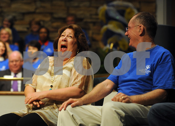 copyright 2012 Sarah A. Miller/Tyler Morning Telegraph  Special guest Margo Martindale laughs as she is introduced to the crowd at the Jacksonville Independent School District 2012-2013 Convocation Friday morning at Central Baptist Church in Jacksonville. Also pictured is Jacksonville Education Foundation president Barry Hughes. Jacksonville natives Emmy award-winning actress Margo Martindale and former AFL football pro Pete Lammons were honored as Influential Indians among others at the event.