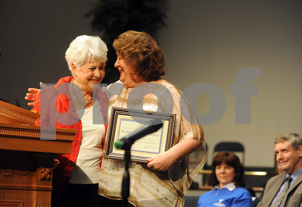 copyright 2012 Sarah A. Miller/Tyler Morning Telegraph  Sissy Austin, left, presents the Influential Indian award to Margo Martindale at the Jacksonville Independent School District 2012-2013 Convocation Friday morning at Central Baptist Church in Jacksonville. Also pictured is Jacksonville Education Foundation president Barry Hughes. Jacksonville natives Emmy award-winning actress Margo Martindale and former AFL football pro Pete Lammons were honored as Influential Indians among others at the event.