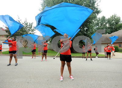 copyright 2012 Sarah A. Miller/Tyler Morning Telegraph  Girls in the color guard of the Robert E. Lee Red Raider Marching Band stop in the street to perform during a parade through the neighborhood around Rice Elementary School in Tyler Saturday morning. The parade was part of the band's second annual March-a-thon fundraiser. They also held a parade around Hubbard Middle School. from 8 a.m. to noon Saturday.