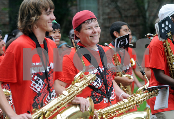 copyright 2012 Sarah A. Miller/Tyler Morning Telegraph  Freshman Casey Roberts marches with his saxophone with the Robert E. Lee Red Raider Marching Band during a parade through the neighborhood around Rice Elementary School in Tyler Saturday morning. The parade was part of the band's second annual March-a-thon fundraiser. They also held a parade around Hubbard Middle School. from 8 a.m. to noon Saturday.