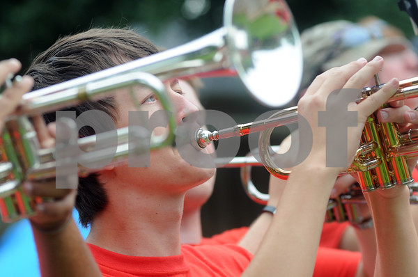 copyright 2012 Sarah A. Miller/Tyler Morning Telegraph  Senior Richard Bryant of the Robert E. Lee Red Raider Marching Band plays the trumpet as the band parades through the neighborhood around Rice Elementary School in Tyler Saturday morning. The parade was part of the band's second annual March-a-thon fundraiser. They also held a parade around Hubbard Middle School. from 8 a.m. to noon Saturday.
