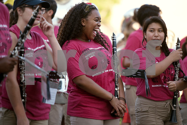Alanah Singleton, 17, smiles after finishing a song during Robert E. Lee Red Raider Band's March-A-Thon in Tyler, Texas, on Saturday, Aug. 19, 2017. The seventh annual March-A-Thon is the band's largest fundraiser and takes the entire band through neighborhoods to play street concerts for donations. (Chelsea Purgahn/Tyler Morning Telegraph)