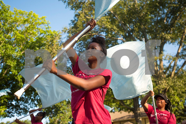 Acacia Clark, 15, performs with the color guard during Robert E. Lee Red Raider Band's March-A-Thon in Tyler, Texas, on Saturday, Aug. 19, 2017. The seventh annual March-A-Thon is the band's largest fundraiser and takes the entire band through neighborhoods to play street concerts for donations. (Chelsea Purgahn/Tyler Morning Telegraph)