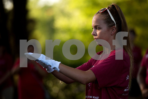 Kelly Ring, 17, directs the band during Robert E. Lee Red Raider Band's March-A-Thon in Tyler, Texas, on Saturday, Aug. 19, 2017. The seventh annual March-A-Thon is the band's largest fundraiser and takes the entire band through neighborhoods to play street concerts for donations. (Chelsea Purgahn/Tyler Morning Telegraph)