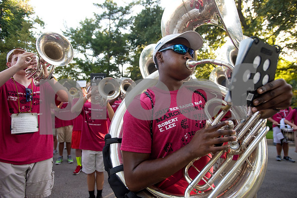 Christopher Whitemore, 14, plays his tuba during Robert E. Lee Red Raider Band's March-A-Thon in Tyler, Texas, on Saturday, Aug. 19, 2017. The seventh annual March-A-Thon is the band's largest fundraiser and takes the entire band through neighborhoods to play street concerts for donations. (Chelsea Purgahn/Tyler Morning Telegraph)