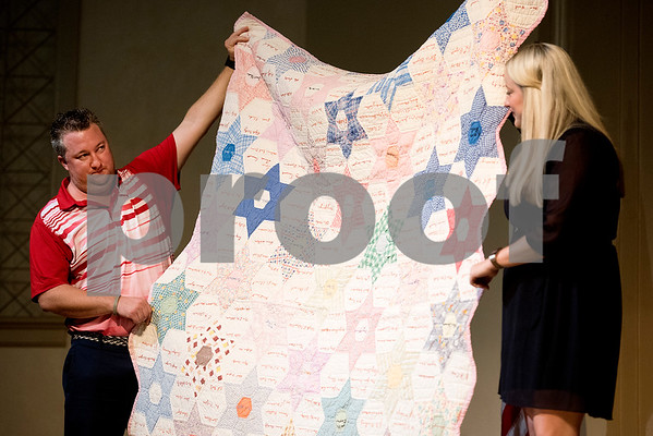 Relatives of J.E. Rhodes hold up a quilt made in the 1930's that will be displayed in J.E. Rhodes Elementary School during a grand opening ceremony for the school in Van, Texas, on Saturday, Aug. 19, 2017. The elementary school was rebuilt after it was demolished in May 2015 due to a tornado. (Chelsea Purgahn/Tyler Morning Telegraph)
