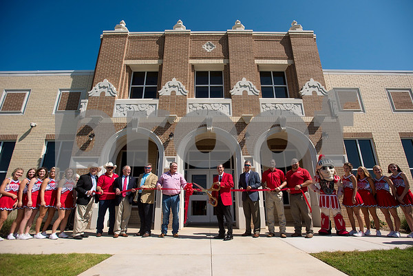 Van Superintendent Don Dunn cuts the ribbon during a grand opening ceremony for J.E. Rhodes Elementary School in Van, Texas, on Saturday, Aug. 19, 2017. The elementary school was rebuilt after it was demolished in May 2015 due to a tornado. (Chelsea Purgahn/Tyler Morning Telegraph)