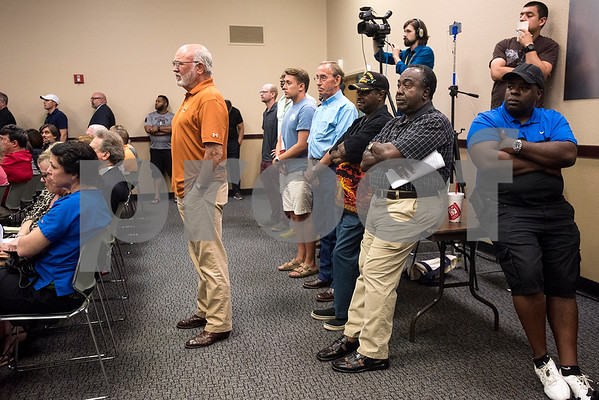 People listen during a Tyler ISD board meeting in Tyler, Texas, on Monday, Aug. 21, 2017. Residents came to discuss changing the name of Robert E. Lee High School, with the discussion being fueled by protests across the nation regarding Confederate monuments. (Chelsea Purgahn/Tyler Morning Telegraph)