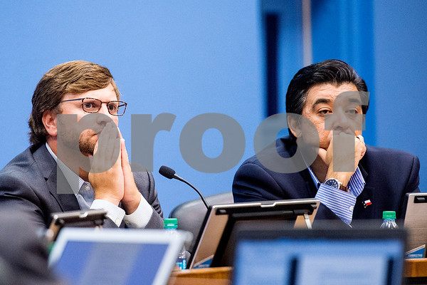 Board members R. Wade Washmon and Aaron Martinez listen during a Tyler ISD board meeting in Tyler, Texas, on Monday, Aug. 21, 2017. Residents came to discuss changing the name of Robert E. Lee High School, with the discussion being fueled by protests across the nation regarding Confederate monuments. (Chelsea Purgahn/Tyler Morning Telegraph)