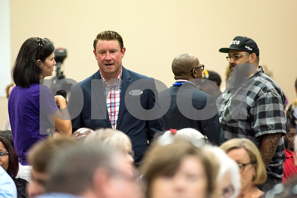 Dr. Dan Crawford, principal of Robert E. Lee High School, second from left, chats with attendees during a Tyler ISD board meeting in Tyler, Texas, on Monday, Aug. 21, 2017. Residents came to discuss changing the name of Robert E. Lee High School, with the discussion being fueled by protests across the nation regarding Confederate monuments. (Chelsea Purgahn/Tyler Morning Telegraph)