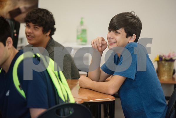 Cumberland Academy High School freshman Dennis Kyriazis listens to principal Denny Lind speak during Squire Camp Friday at the school in Tyler. During Squire Camp freshman participate in different stations and activities to get acquainted with the school, teachers, and classmates.  (Sarah A. Miller/Tyler Morning Telegraph)