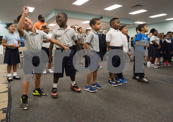 Ryder Mathis, 6, and Jathan Jackson, 6, dance together as the start of the school assembly at Promise Academy, a private Christian school in Tyler on the first day of school on Thursday Aug. 23, 2018. The school has a new location inside the Boys and Girls Club building, 504 W. 32nd Street.  (Sarah A. Miller/Tyler Morning Telegraph)
