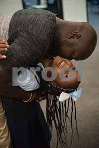 Bryson Jackson hugs his daughter Miracle Jackson, 5, on the first day of school at Promise Academy in Tyler on Thursday Aug. 23, 2018. The school has a new location inside the Boys and Girls Club building, 504 W. 32nd Street.  (Sarah A. Miller/Tyler Morning Telegraph)