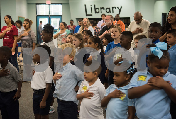 Students, staff and parents recite the Pledge of Allegiance  at Promise Academy, a private Christian school in Tyler on the first day of school on Thursday Aug. 23, 2018. The school has a new location inside the Boys and Girls Club building, 504 W. 32nd Street.  (Sarah A. Miller/Tyler Morning Telegraph)