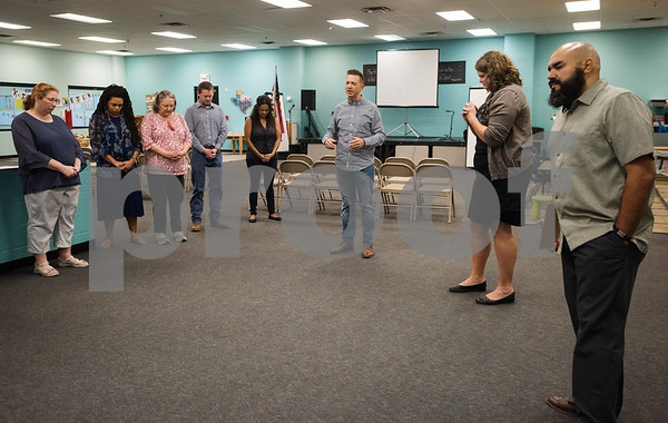 Les Harvey of Church of the Pines leads a prayer with Promise Academy staff and other local pastors before the start of the first day of classes at Promise Academy, a private Christian school in Tyler on Thursday Aug. 23, 2018. The school has a new location inside the Boys and Girls Club building, 504 W. 32nd Street.  (Sarah A. Miller/Tyler Morning Telegraph)