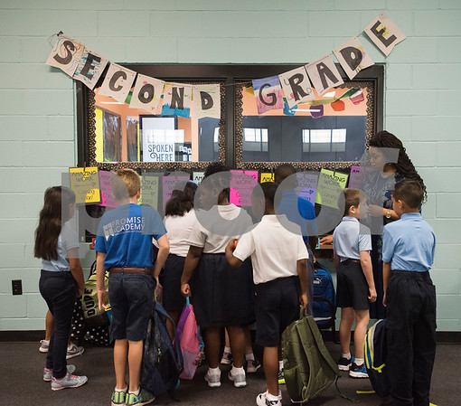 Second grade teacher Gloria Johnson has her students hang up their backpacks for entering her classroom at Promise Academy, a private Christian school in Tyler for the first day of school on Thursday Aug. 23, 2018. The school has a new location inside the Boys and Girls Club building, 504 W. 32nd Street.  (Sarah A. Miller/Tyler Morning Telegraph)