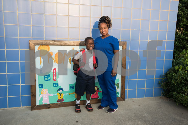 Jathan Jackson, 6, and his mother Evelyn Jackson as they arrive for the first day of school at Promise Academy in Tyler on Thursday Aug. 23, 2018. The school has a new location inside the Boys and Girls Club building, 504 W. 32nd Street.  (Sarah A. Miller/Tyler Morning Telegraph)
